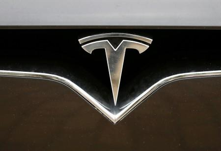 FILE PHOTO: The Tesla logo is pictured on a car during the electric car E-Rallye Baltica 2019
