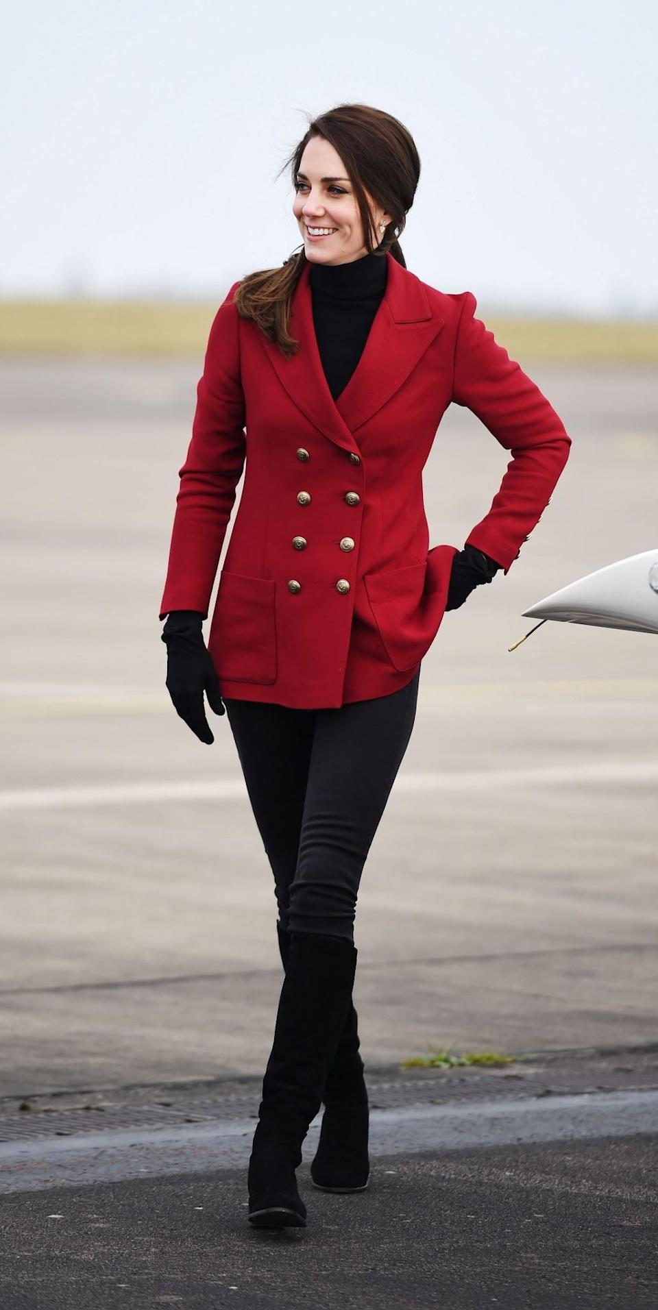 <p>The Duchess spent Valentine's Day with young Air Cadets at an RAF base near Peterborough. She suitably wore a military-inspired look featuring a double-breasted red jacket by Philosophy di Lorenzo Serafini and her favourite suede Stuart Weitzman boots.<br><i>[Photo: PA]</i> </p>