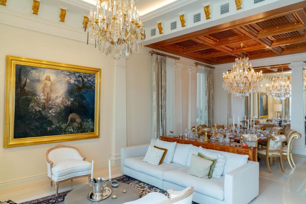 A painting is displayed in the living room of a house developed by National Electronics Holdings Ltd. and Baring Private Equity Asia Real Estate in Hong Kong, China, on Wednesday, Feb. 20, 2019. The cluster of homes nestled on a piece of land overlooking the South China Sea is the first property project National Managing Director Loewe Lee has overseen from start to finish. Five of the seven houses have been painstakingly fitted out with everything a modern multimillionaire could want. All a buyer need do is bring a suitcase, and $75 million (for one dwelling, that is). Photographer: Anthony Kwan/Bloomberg