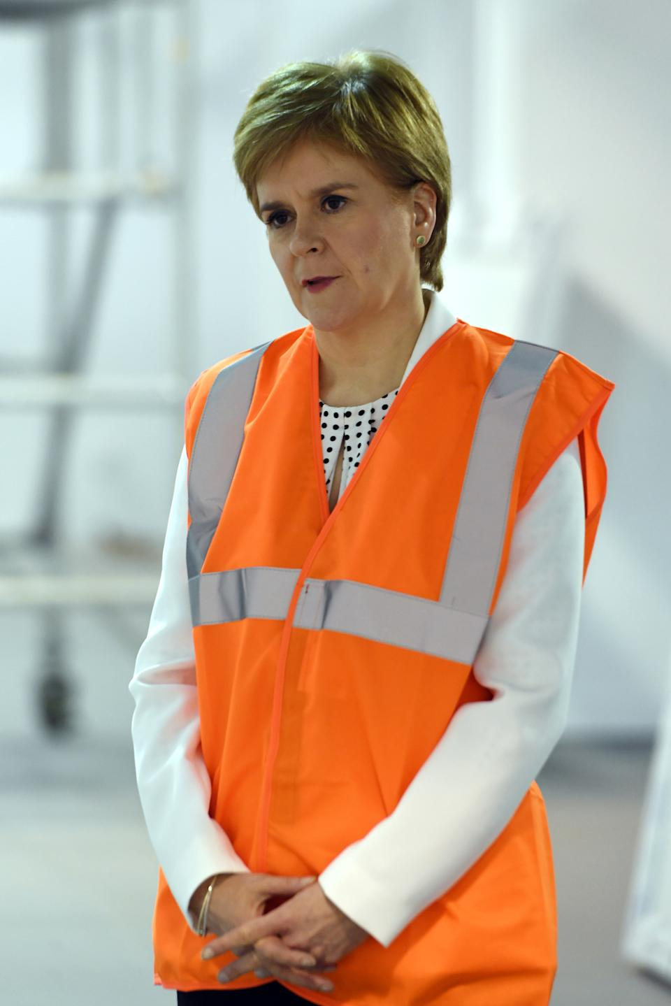 GLASGOW, SCOTLAND - APRIL 10: Scotland's First Minister Nicola Sturgeon tours the NHS Louisa Jordan field hospital, set up at the Scottish Events Campus (SEC) to potentially help with extra patients caused by the coronavirus COVID-19 pandemic on April 10, 2020 in Glasgow, Scotland. There have been over 60,000 reported cases of the COVID-19 coronavirus in the United Kingdom and 8,958 deaths. The country is in its third week of lockdown measures aimed at slowing the spread of the virus. (Photo by Andy Buchanan - WPA Pool / Getty Images)