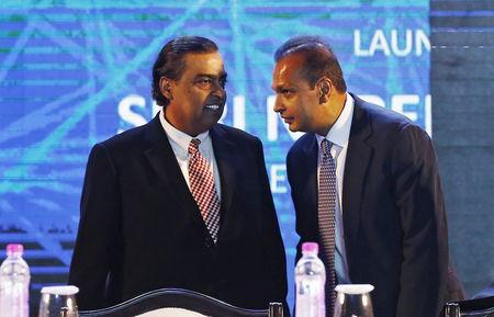 "FILE PHOTO: Anil Ambani (R), chairman of the Reliance Anil Dhirubhai Ambani Group, talks to his brother Mukesh Ambani, chairman of Reliance Industries Limited, during the launch of ""Digital India Week"" in New Delhi, India, July 1, 2015. REUTERS/Adnan Abidi"