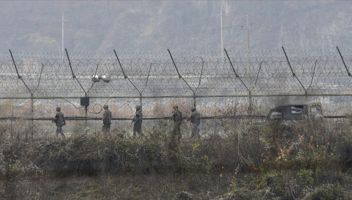 FILE - In this Nov. 16, 2018, file photo, South Korean army soldiers patrol along the barbed-wire fence in Paju, South Korea, near the border with North Korea. A North Korean diplomat who served as the country's acting ambassador to Kuwait has defected to South Korea, according to South Korean lawmakers who were briefed by Seoul's spy agency on Tuesday, Jan. 26, 2021. (AP Photo/Ahn Young-joon, File)