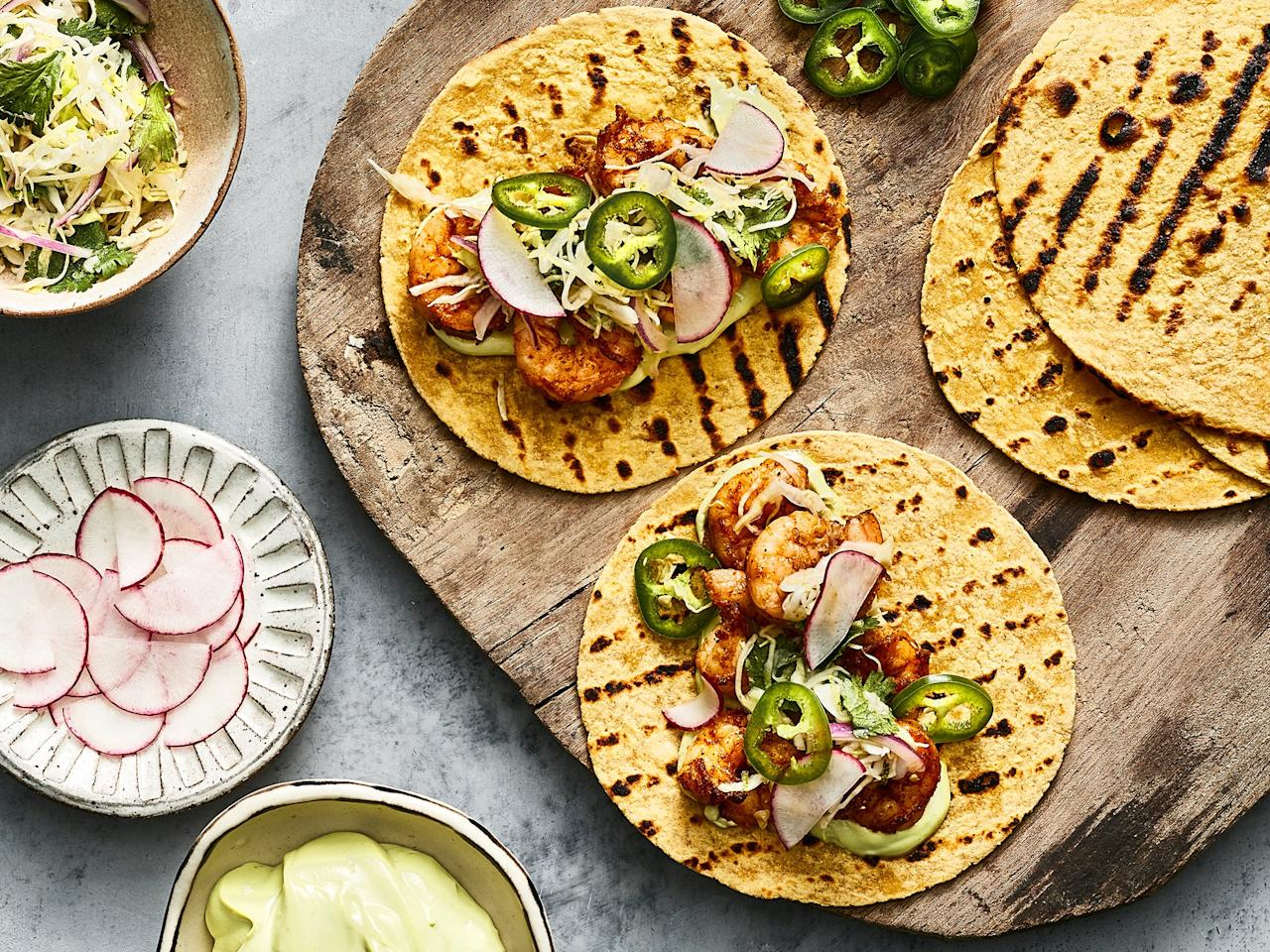 "<p>These easy shrimp tacos are apt to become one of your favorite weeknight dinner go-to's. They're ridiculously fast, they're easily adapted to suit picky palates, and wow, <i>TACO</i> bout flavor. A few pantry spices and about five minutes under the broiler are all it takes to transform raw shrimp into a dynamite taco filling. We add bright crunch with a fresh and zesty cabbage slaw, featuring lime and cilantro, and an element of richness with a simple avocado crema. Of course, feel free to top your shrimp tacos however you choose! You can skip the slaw and opt for shredded lettuce and radishes for a vibrant crispy bite. Or layer on sliced avocado in place of the crema. This is your taco night, after all—do what feels right. And yes, that means that both corn or flour tortillas will work perfectly well here; just be sure to warm them up a bit before layering on your shrimp and toppings.</p> <p><a href=""https://www.myrecipes.com/recipe/shrimp-tacos-cabbage-slaw"">Shrimp Tacos with Cilantro-Lime Slaw&nbsp; Recipe</a></p>"