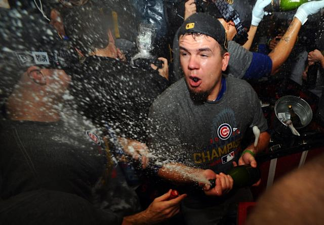 <p>Chicago Cubs player Kyle Schwarber (12) celebrates in the clubhouse after defeating the Cleveland Indians in game seven of the 2016 World Series at Progressive Field. Mandatory Credit: Ken Blaze-USA TODAY Sports </p>
