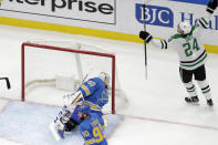 Dallas Stars' Roope Hintz (24), of Finland, celebrates after scoring the game-winning goal past St. Louis Blues goaltender Jordan Binnington (50) and Ryan O'Reilly (90) during overtime of an NHL hockey game Saturday, Feb. 8, 2020, in St. Louis. (AP Photo/Jeff Roberson)