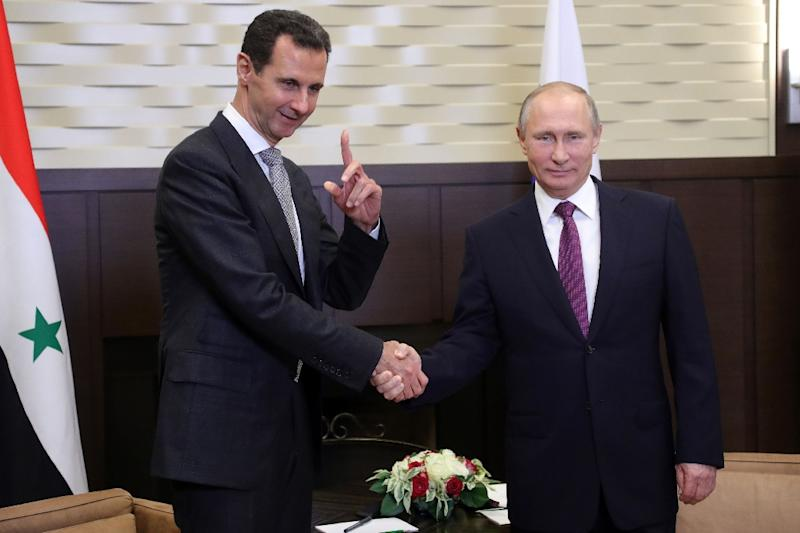 Putin meets Assad in Sochi on the eve of a three-way summit between the Russian, Turkish and Iranian presidents (AFP Photo/Mikhail KLIMENTYEV)
