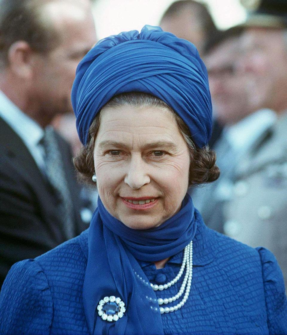 """<p>Princess Diana's engagement ring design was inspired by the Prince Albert Brooch, seen here on Queen Elizabeth II during her visit to Saudi Arabia in 1979. The piece, which its namesake consort gifted to Queen Victoria <a href=""""https://www.townandcountrymag.com/society/tradition/news/a9209/queen-victoria-wedding/"""" rel=""""nofollow noopener"""" target=""""_blank"""" data-ylk=""""slk:on the eve of their wedding"""" class=""""link rapid-noclick-resp"""">on the eve of their wedding</a>, was beloved by the monarch and is now an important piece in her great-great-granddaughter's collection. Upon her death in 1901, Queen Victoria designated the brooch an heirloom of the crown, meaning it would be specifically reserved for use by future queens and queen consorts. </p>"""