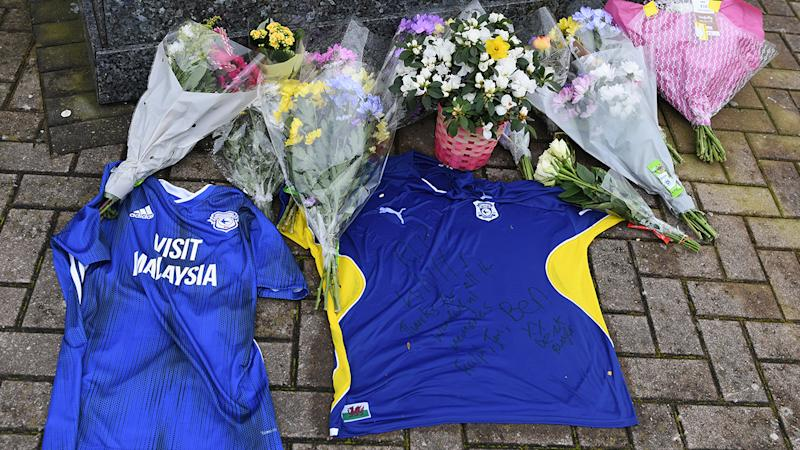 Floral and shirt tributes, pictured here at the Fred Keenor statue in memory of Peter Whittingham.