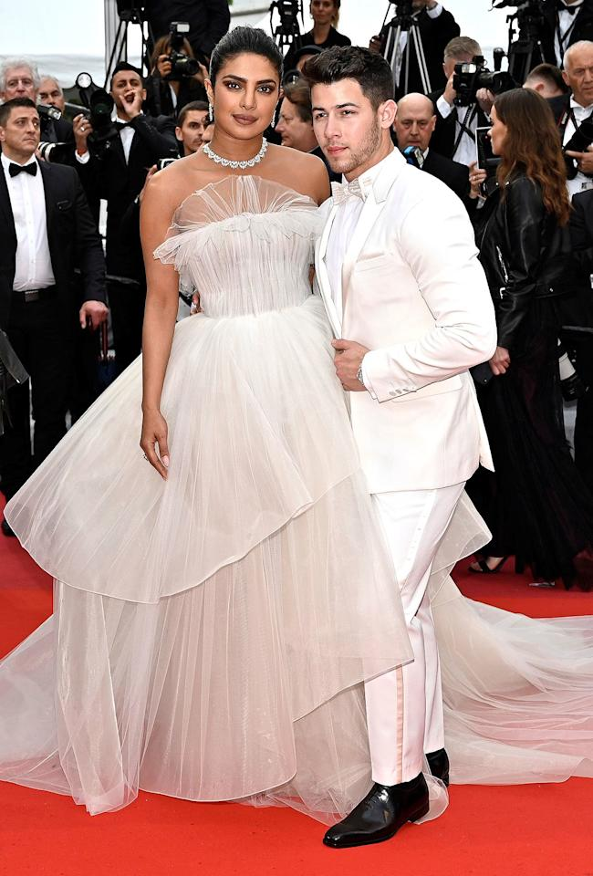 "You couldn't script a better fashion fairy tale:  <a href=""https://people.com/music/nick-jonas-2019-met-gala-with-priyanka-chopra-will-be-full-circle-moment/"">first ""date"" at the Met Gala (in 2017)</a>, followed by a whirlwind romance and <a href=""https://people.com/tv/priyanka-chopra-on-extravagant-wedding-to-nick-jonas/"">two over-the-top weddings</a> (plus infinite parties!) that capitaved the globe — and 'gram. ""Together they create that chic Old Hollywood aesthetic,"" says Chopra Jonas' stylist <a href=""https://www.instagram.com/mimi/?hl=en"" target=""_blank"">Mimi Cuttrell</a>. To be clear, there was no Cinderella makeover for Chopra Jonas, 37, or Jonas, 26. ""They are both true to their individual styles,"" says Jonas' pro <a href=""https://www.instagram.com/avoyermagyan/?hl=en"" target=""_blank"">Avo Yermagyan</a>. ""It's another example of how they are such a perfect match.""  —Priyanka in a Georges Hobeika gown and Nick in a Berluti tuxedo at the Cannes Film Festival."