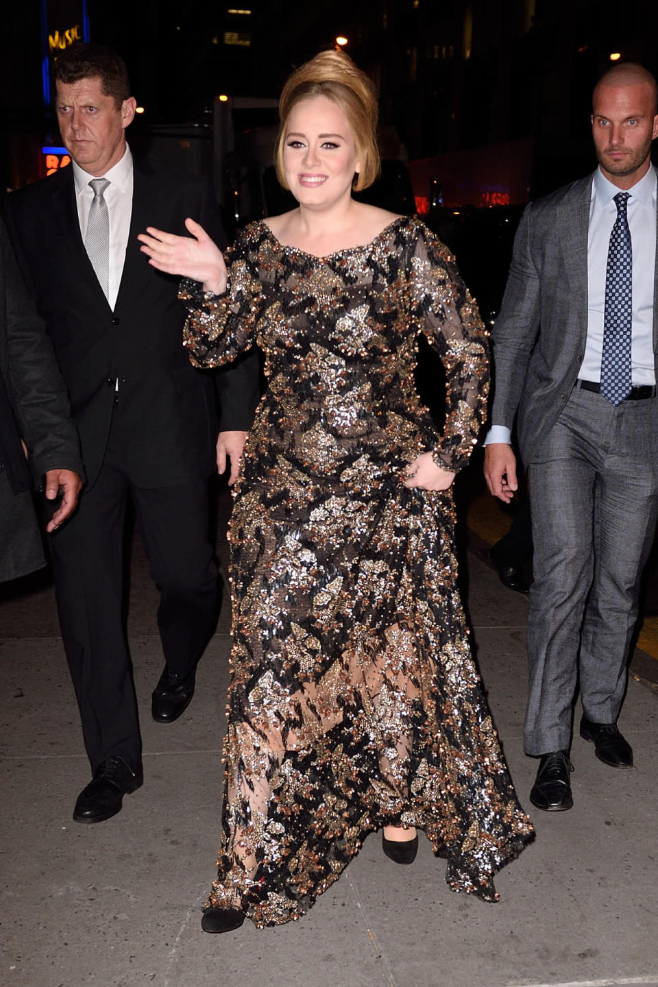 <p>For her first concert in four years, Adele dressed for the special occasion. Calling on her favorite designer Jenny Packham (Kate Middleton's, too!), she went for a black tie look in a full-length, long-sleeve piece completely covered in sequins in festive fall colors. While her shoulder-length hair is usually styled down with a lot of volume, she put it up in a chignon with a center part and wispy bangs. <i>Photo: AKM-GSI</i></p>