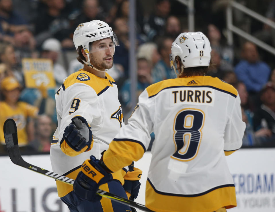 Nashville Predators' Filip Forsberg (9) celebrates with teammate Kyle Turris (8) after scoring his second goal against the San Jose Sharks in the second period of an NHL hockey game in San Jose, Calif., Tuesday, Nov. 13, 2018. (AP Photo/Josie Lepe)