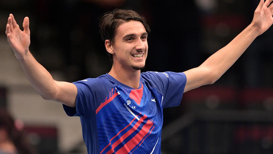 Lorenzo Sonego is pictured celebrating after defeating Novak Djokovic.