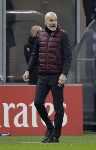 AC Milan's manager Stefano Pioli stands during a Serie A soccer match between AC Milan and Parma, at the San Siro stadium in Milan, Italy, Sunday, Dec. 13, 2020. (AP Photo/Luca Bruno)