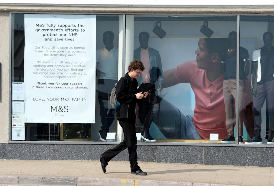 WEYMOUTH, ENGLAND - APRIL 05: A Marks & Spencer shop front information notice on April 05, 2020 in Weymouth, United Kingdom. The Coronavirus (COVID-19) pandemic has spread to many countries across the world, claiming over 60,000 lives and infecting over 1 million people. (Photo by Finnbarr Webster/Getty Images)