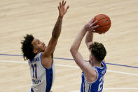 Pittsburgh's Justin Champagnie (11) defends as Duke's Matthew Hurt shoots during the second half of an NCAA college basketball game, Tuesday, Jan. 19, 2021, in Pittsburgh. Pittsburgh won 79-73. (AP Photo/Keith Srakocic)