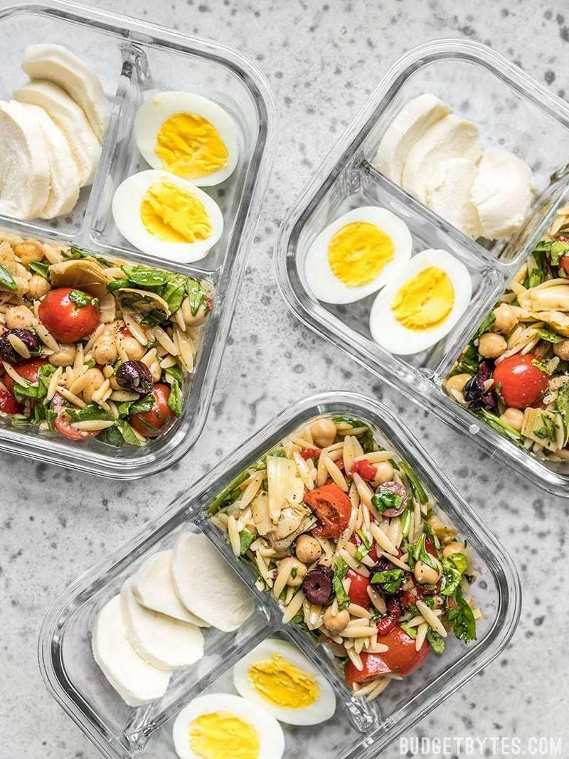 Orzo bowls with mozzarella and hard boiled eggs.
