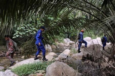 Members of Malaysian rescue team take part in a search and rescue operation for 15-year-old Irish girl Nora Anne Quoirin who went missing from a resort in Seremban.
