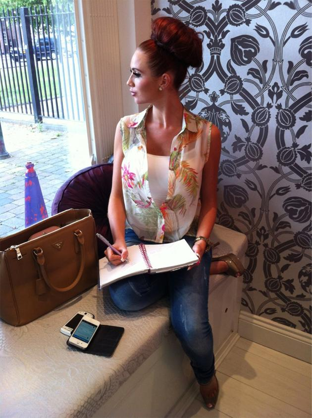 Celebrity photos: Amy Childs has been one busy lady recently, what with the launch of her new perfume and boutique. However, she took some time out during a business meeting to tweet this picture, showing off her impressive hair do.
