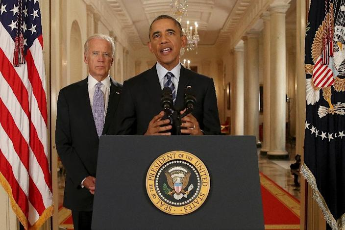 US President Barack Obama, standing with Vice President Joe Biden, delivers remarks in the East Room of the White House in Washington, DC on July 14, 2015, after an Iran nuclear deal was reached (AFP Photo/Andrew Harnik)