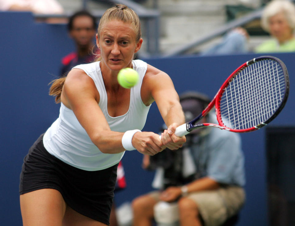 FILE- In this Aug. 30, 2006, file photo Mary Pierce of France returns a shot to Elena Vesnina of Russia at the US Open tennis tournament in New York. Pierce joins Yevgeny Kafelnikov and Li Na in the International Tennis Hall of Fame Class of 2019, which was announced Monday, Jan. 21, 2019, at the Australian Open. (AP Photo/Ed Betz, File)