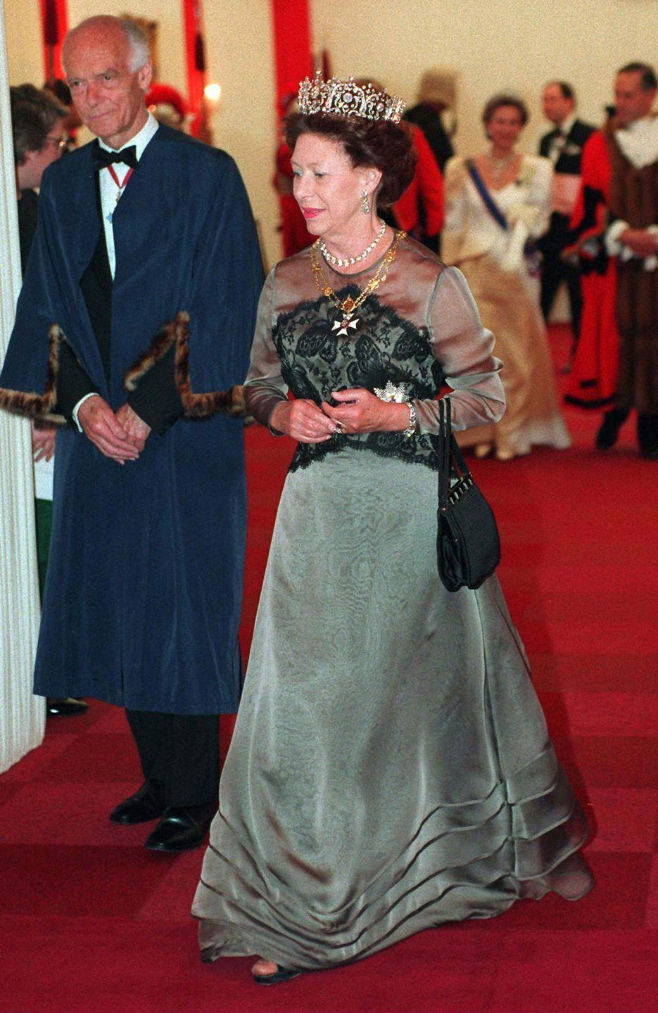<p>In 1995, Princess Margaret wore a green long-sleeve evening gown finished with a hunter embroidered bodice to a state banquet in London.</p>
