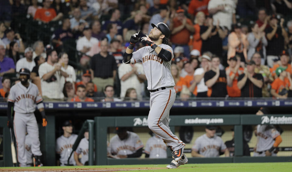 Brandon Crawford hit a home run off his brother-in-law Gerrit Cole Tuesday while his sister watched awkwardly from the stands. (AP)