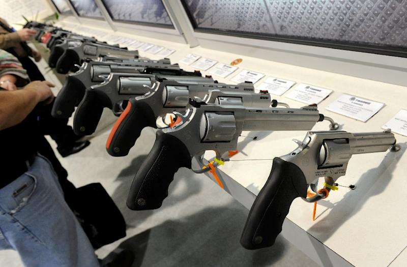 Handguns are displayed at the Taurus International Firearms booth at  a gun show in 2011 in Las Vegas
