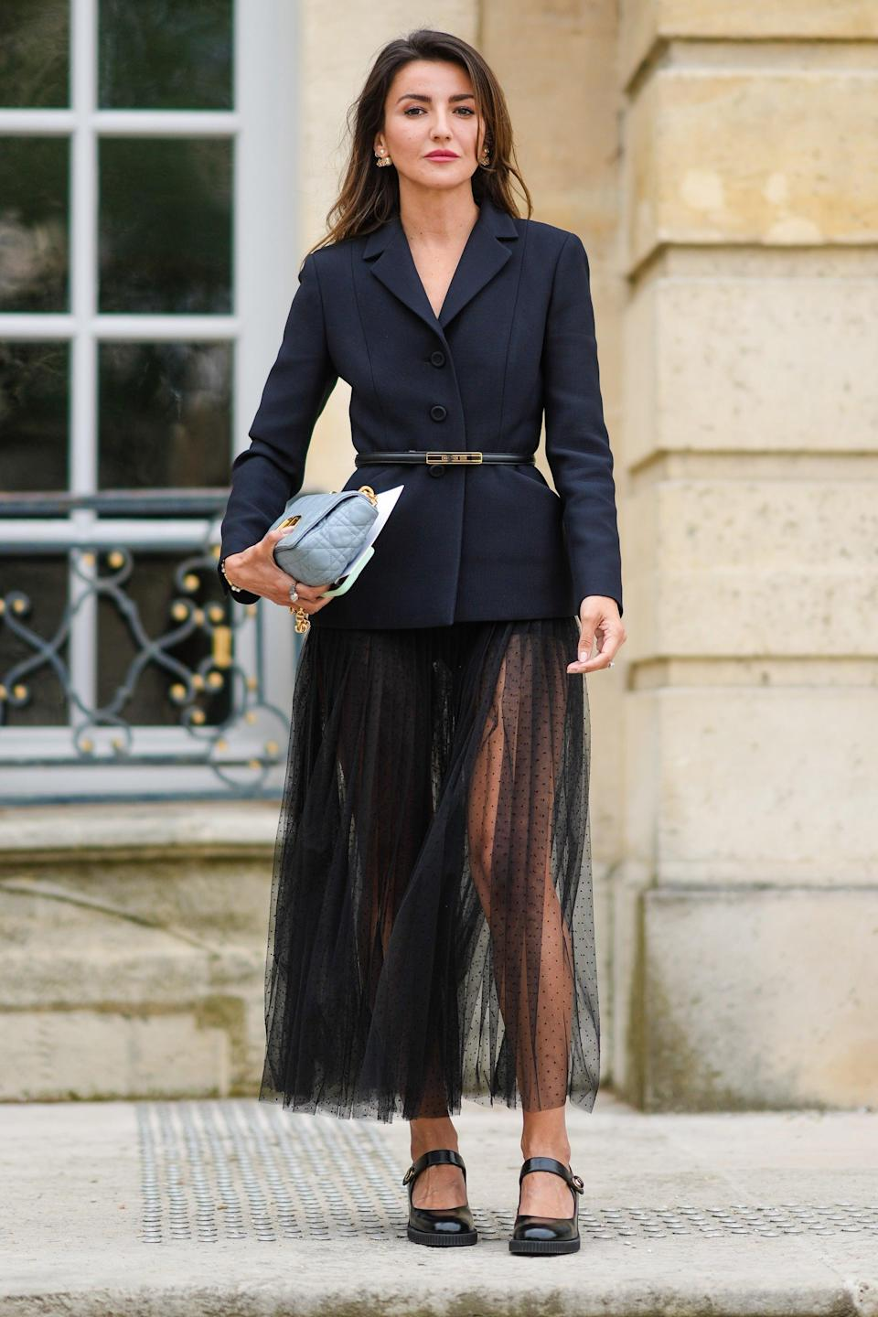 """Influencer Alexandra Pereira is ballet-ready in a flowy maxi skirt, paired with a black belted blazer. <span class=""""copyright"""">Photo: Edward Berthelot/Getty Images.</span>"""
