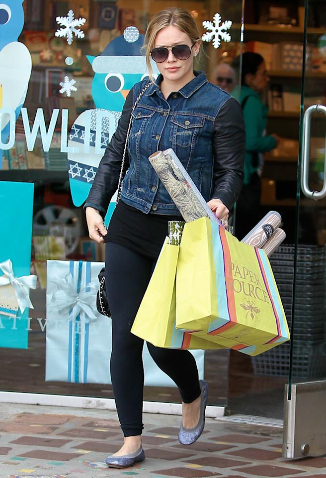 December 05, 2012: Eight months after giving birth to son Luca (not pictured), Hilary Duff is back in tight pants spotted shopping for wrapping paper in Los Angeles, CA.