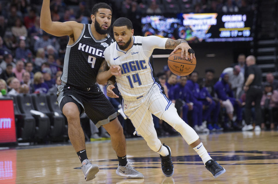 Orlando Magic guard D.J. Augustin (14) drives toward the basket past Sacramento Kings guard Cory Joseph (9) during the first quarter of an NBA basketball game in Sacramento, Calif., Monday, Jan. 13, 2020. (AP Photo/Randall Benton)