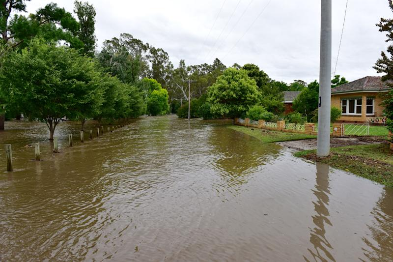 Flash floods could spell new complications for firefighters in Victoria. Pictured is a stock image of floods in the Alpine region.