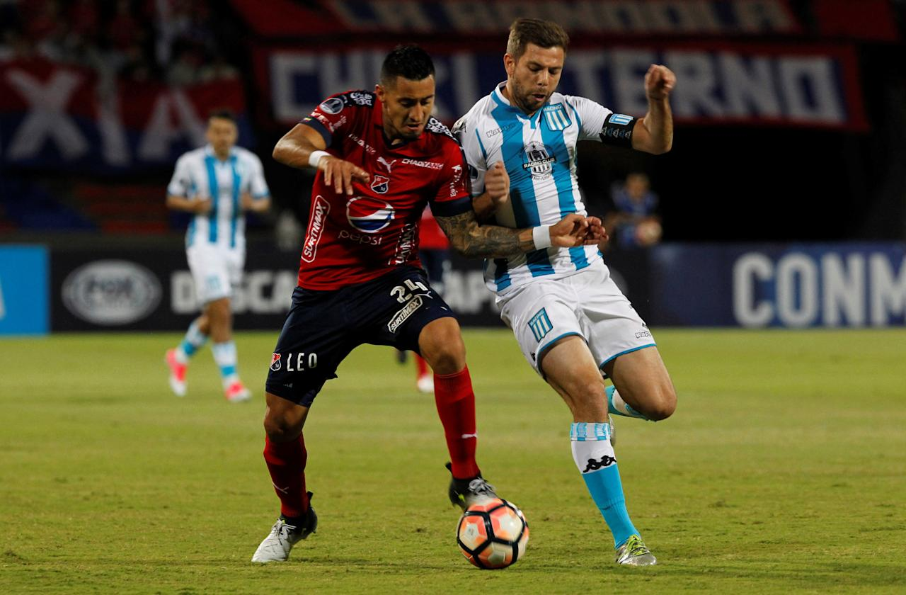 Football Soccer - Colombia's Independiente Medellin v Argentina's Racing Club – Copa Sudamericana - Atanasio Girardot Stadium, Medellin, Colombia - July 27, 2017. Independiente Medellin's Jonathan Lopera (L) and Racing Club's Leandro Grimi in action. REUTERS/Fredy Builes