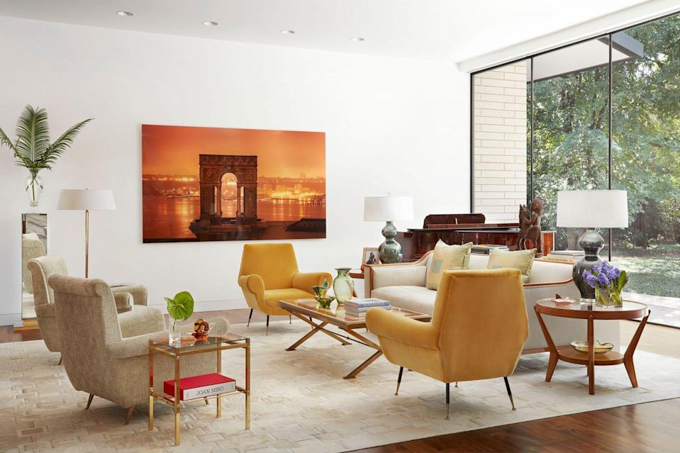 Open Floor Plan with White Walls Mid-Century Furniture