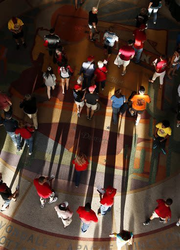 Fans arrive at Chase Field prior to a baseball game between the Arizona Diamondbacks and the St. Louis Cardinals, Monday, April 1, 2013, in Phoenix. (AP Photo/Ross D. Franklin)