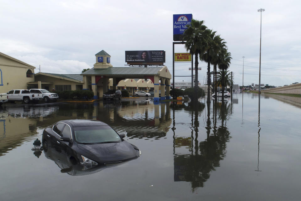 Several cars were flooded along Interstate 10 in Southeast Texas, Thursday, Sept. 19, 2019, due to Tropical Storm Imelda. (Photo: Guiseppe Barranco/The Beaumont Enterprise via AP)