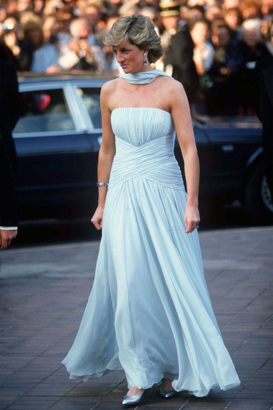 <p>In a strapless baby-blue Catherine Walker dress at the Cannes Film Festival.</p>