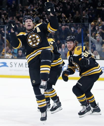 Boston Bruins' David Backes, left, celebrates his goal in front of teammate David Pastrnak (88) during the second period of an NHL hockey game against the Toronto Maple Leafs in Boston, Saturday, Dec. 8, 2018. (AP Photo/Michael Dwyer)