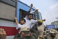 Members of National Students' Union of India (NSUI), are being detained and taken away by police during protest marking the second anniversary of Indian government scrapping Kashmir's semi- autonomy in Jammu, India, Thursday, Aug. 5, 2021. On Aug. 5, 2019, Indian government passed legislation in Parliament that stripped Jammu and Kashmir's statehood, scrapped its separate constitution and removed inherited protections on land and jobs. (AP Photo/Channi Anand)