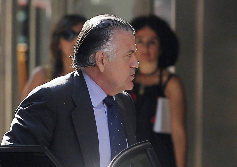 Former Popular Party treasurer, Luis Barcenas arrives the National Court in Madrid, Spain, Thursday, June 27, 2013. A judge has ordered that Barcenas represented a flight risk and should be held in jail while he awaits trial on charges of tax fraud and money laundering. Barcenas was treasurer of Prime Minister Mariano Rajoy's ruling Popular Party from 2008 to 2009 and a senator from 2004 to 2010. He is accused of keeping up to 47 million euros in secret Swiss bank accounts. (AP Photo/Andres Kudacki)