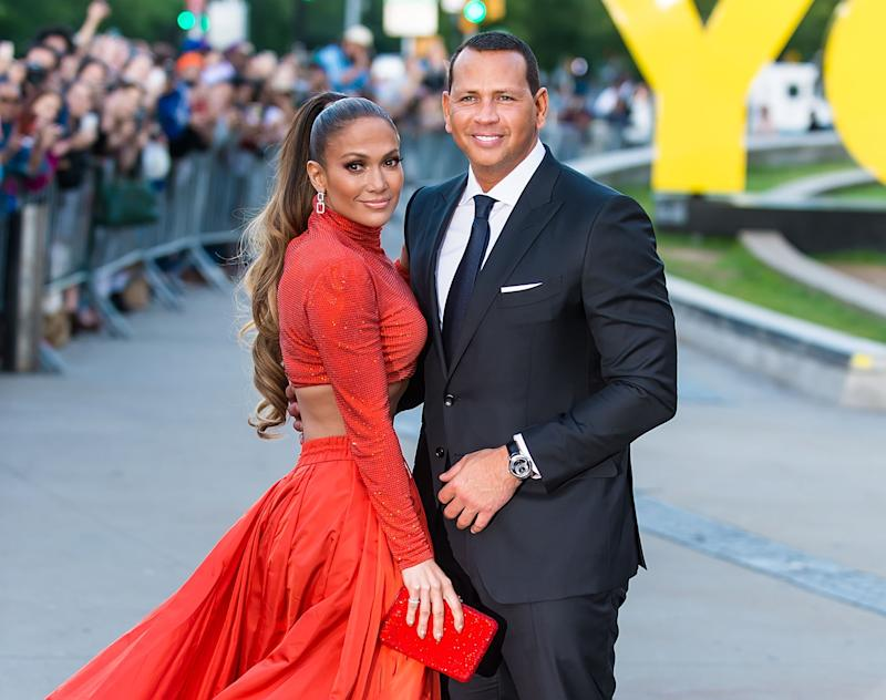 Jennifer Lopez and Alex Rodriguez pose at an event