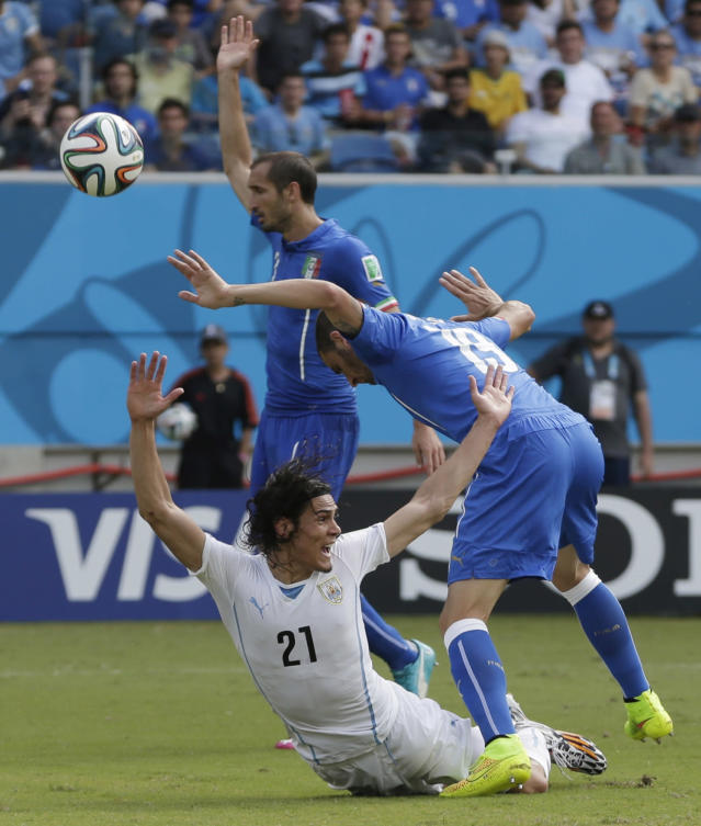 Uruguay's Edinson Cavani reacts after being tripped by Italy's Leonardo Bonucci during the group D World Cup soccer match between Italy and Uruguay at the Arena das Dunas in Natal, Brazil, Tuesday, June 24, 2014. (AP Photo/Petr David Josek)
