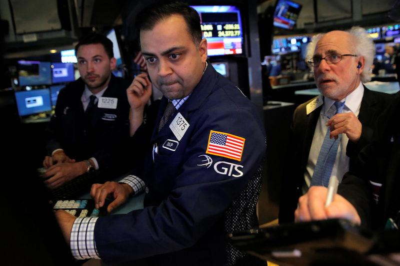 Traders work on the floor at the New York Stock Exchange (NYSE) in Manhattan, New York