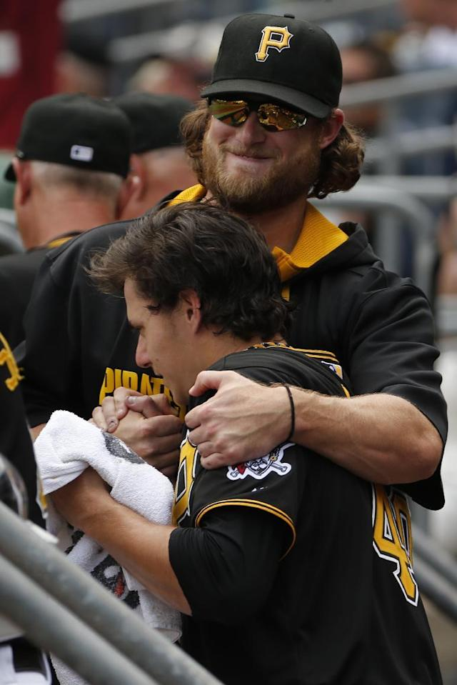 Pittsburgh Pirates' starting pitcher Jeff Locke, front, is congratulated by teammate pitcher Gerrit Cole after leaving a baseball game against the St. Louis Cardinals in the eighth inning, Wednesday, Aug. 27, 2014. The Pirates won 3-1 won, with Locke getting the win. (AP Photo/Gene J. Puskar)