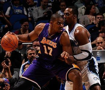 Howard had 21 points and 23 rebounds in the Magic's victory over Bynum and the Lakers. Bynum had 10 points and 12 boards