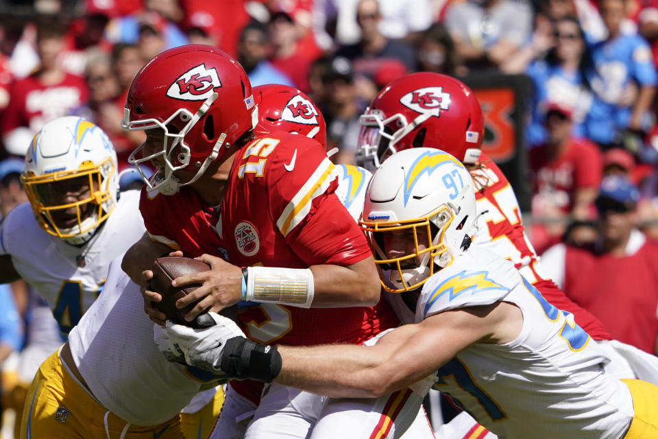 Kansas City Chiefs' Patrick Mahomes (15) is sacked by Los Angeles Chargers' Joey Bosa (97) during the first half of an NFL football game, Sunday, Sept. 26, 2021, in Kansas City, Mo. (AP Photo/Ed Zurga)
