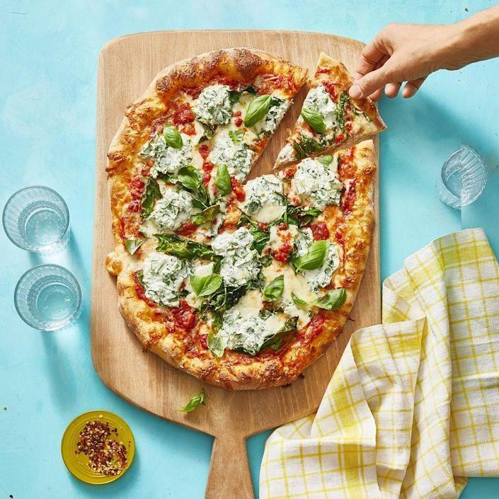 """<p>Introducing the pasta-pizza-mash-up you've been waiting for. Topped with marinara, herby ricotta, and, of course, lots of mozzarella, you've found your new favorite pie. </p><p><em><a href=""""https://www.womansday.com/food-recipes/food-drinks/a31001915/lasagna-style-pizza-recipe/"""" rel=""""nofollow noopener"""" target=""""_blank"""" data-ylk=""""slk:Get the Lasagna-Style Pizza recipe."""" class=""""link rapid-noclick-resp"""">Get the Lasagna-Style Pizza recipe.</a></em></p>"""