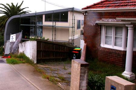 A make-shift fence can be seen out the front of a property being redeveloped which has been registered by Cambridge Analytica as their Australian office in the Sydney beachfront suburb of Maroubra