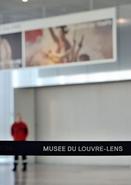 "A security guard blocks the entrance of the ""Galerie du Temps"" at the Louvre-Lens Museum in the French northern city of Lens, on February 8, 2013. The museum has been closed after an attack on a Delacroix masterpiece"