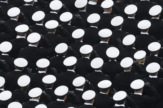 Navy midshipmen march onto the field before an NCAA college football game against the Army, Saturday, Dec. 14, 2013, in Philadelphia. (AP Photo/Matt Rourke)