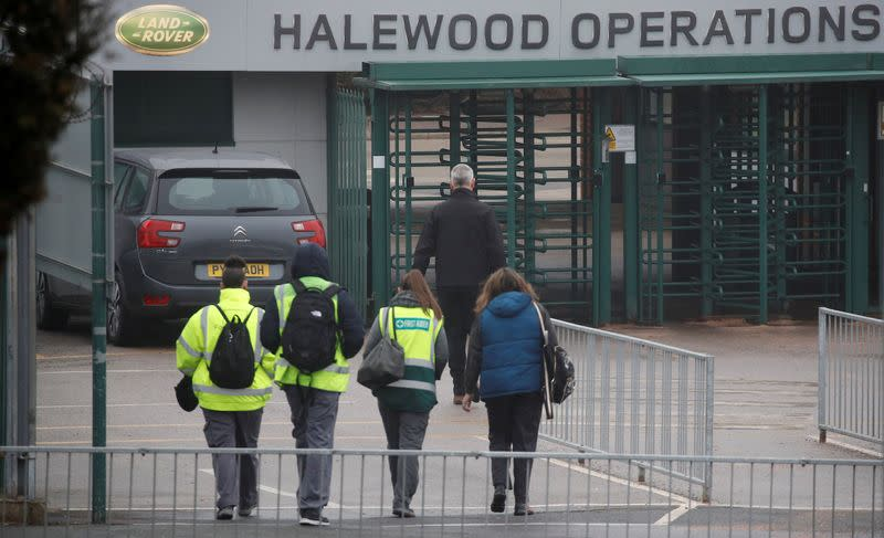 Workers arrive at Jaguar Land Rover's Halewood Plant in Liverpool